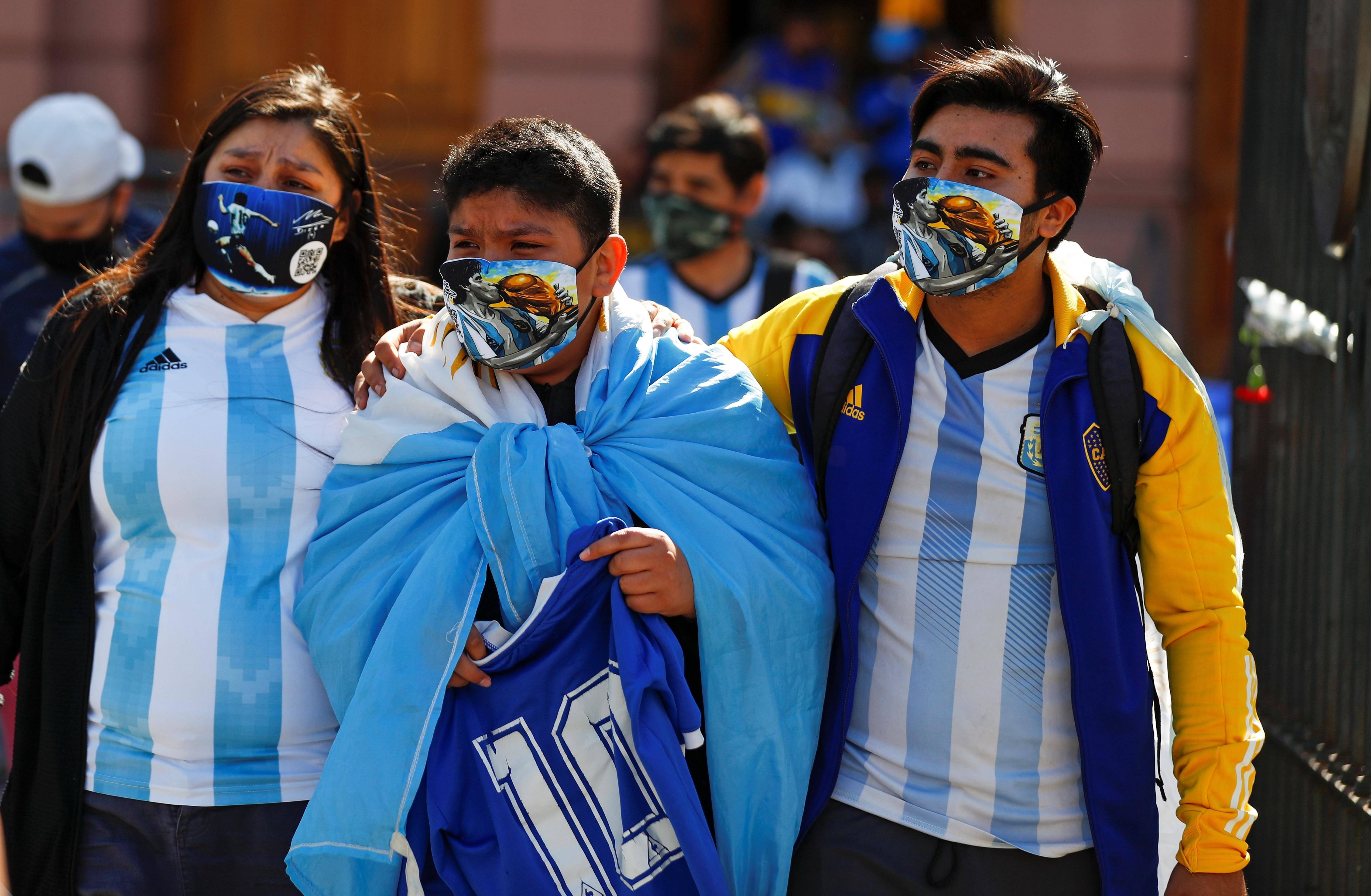 Argentines mourn football hero Maradona as family seeks quick burial