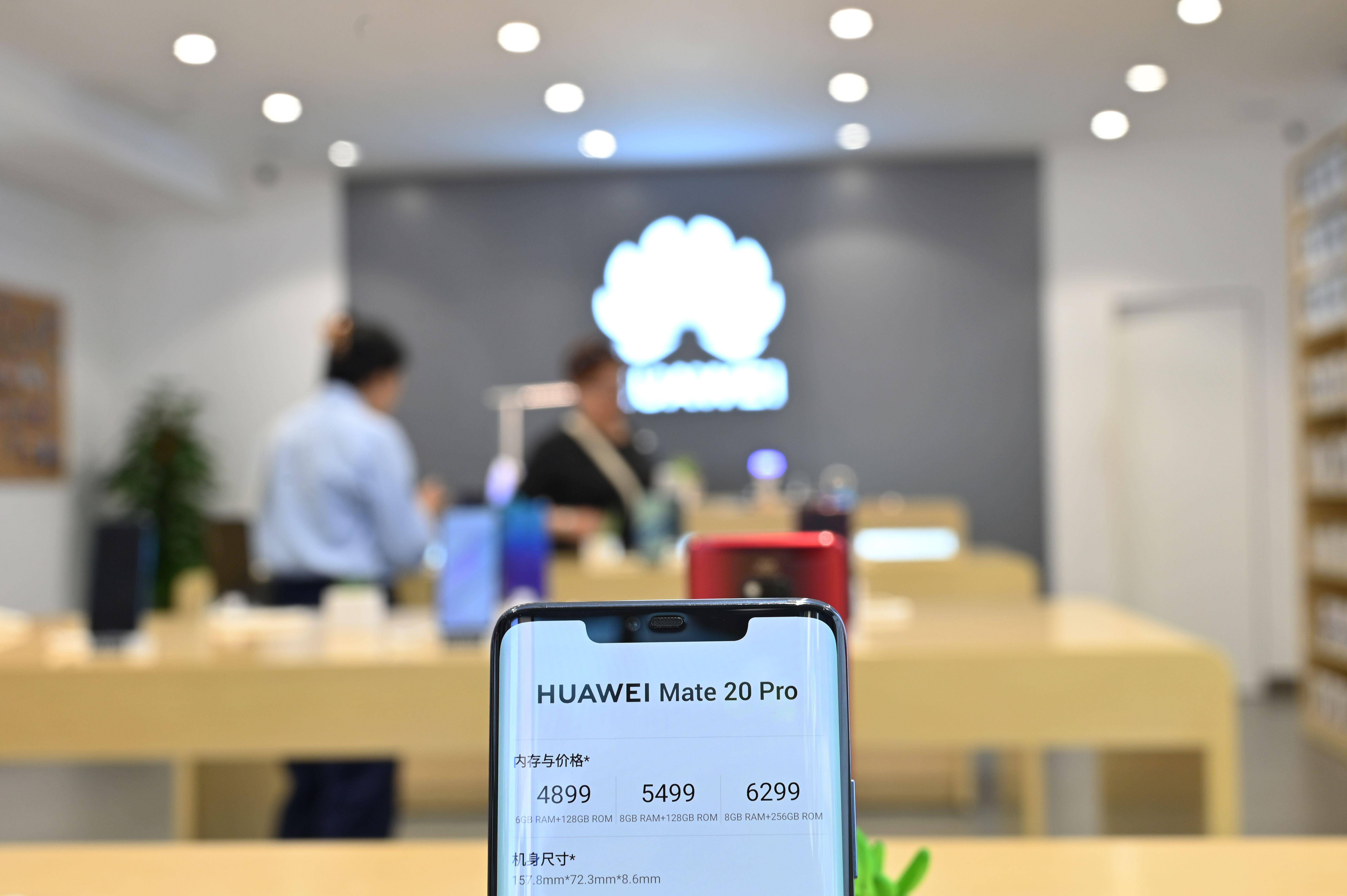 Huawei to cut phone production by over half in 2021