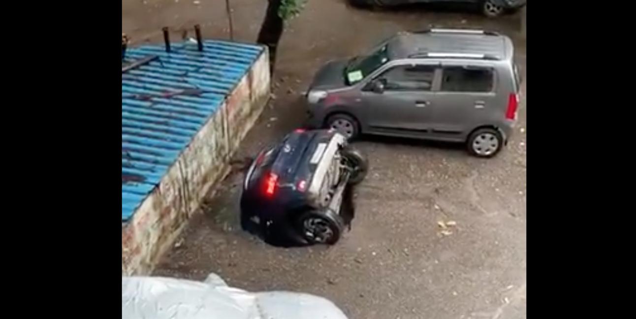 Video: Car vanishes into well as rain batters Mumbai